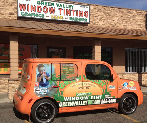 The Storefront of Green Valley Window Tinting Las Vegas Alongside Their GV Las Vegas Window Tint Van That's Orange Parked Outside